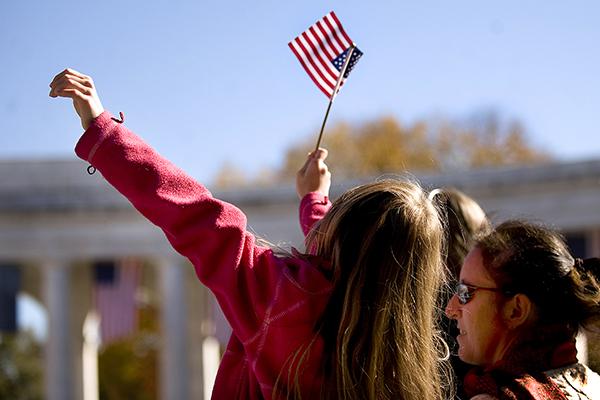 girls waving American flag
