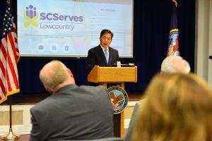 U.S. Department of Labor Deputy Secretary Christopher Lu standing at podium