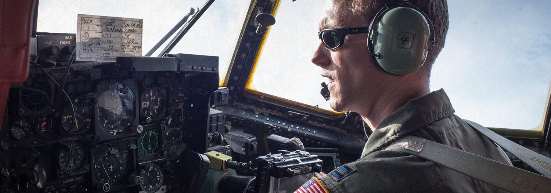 Pilot sitting at controls of aircraft