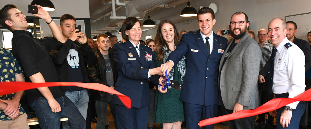 veterans opening new business by cutting red ribbon
