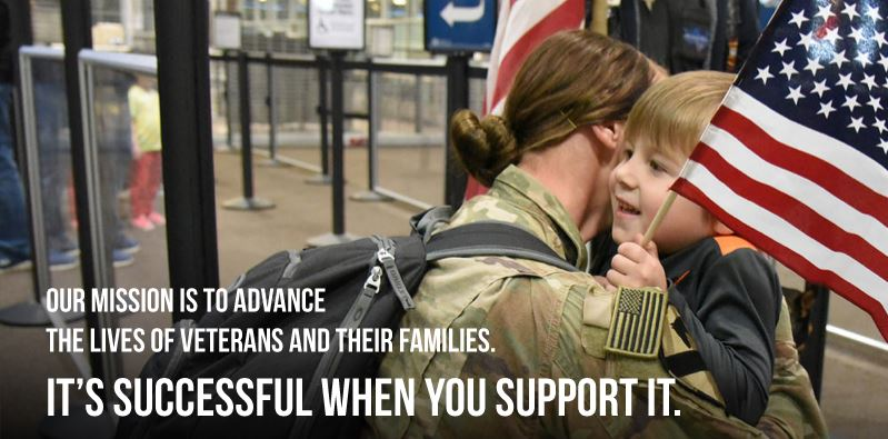 "Female soldier hugging her child in an airport with caption reading ""our mission is to advance the lives of veterans and their families. It's successful when you support it."""
