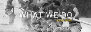 """Soldiers playin tug-of-war with text reading """"what we do."""""""