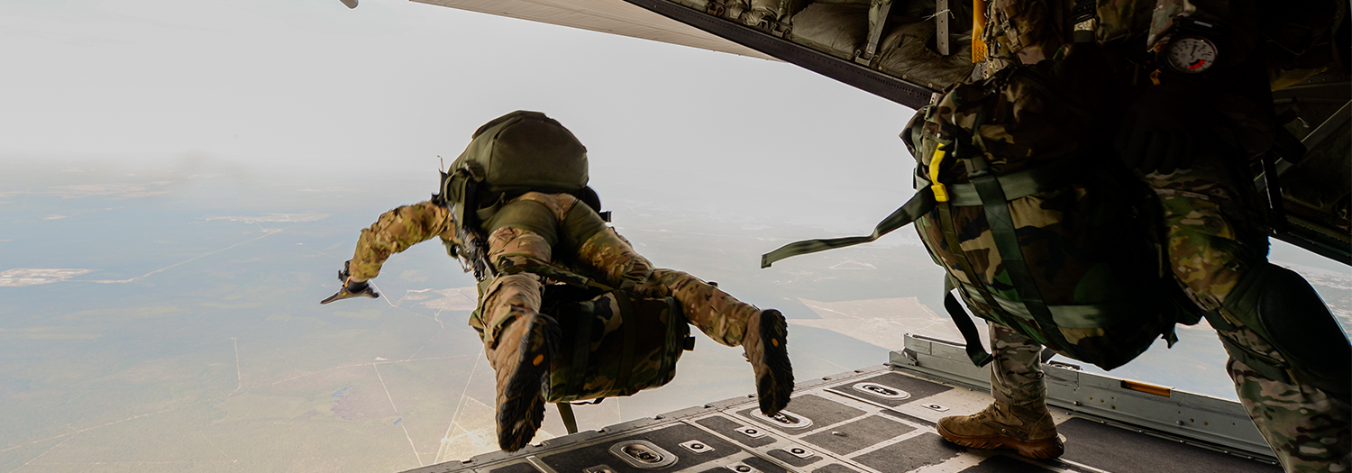 U.S. Army Green Berets from the 7th Special Forces Group jump out of a C-130H3 Hercules for Emerald Warrior at Hurlburt Field, Florida.