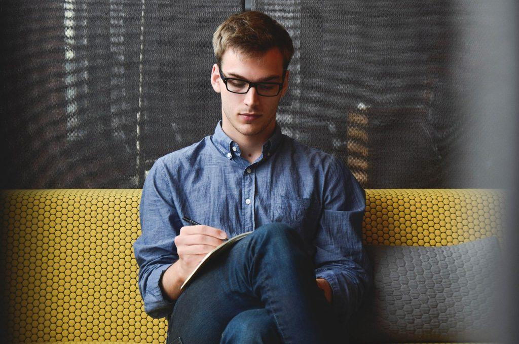Entrepreneur writing in notebook.