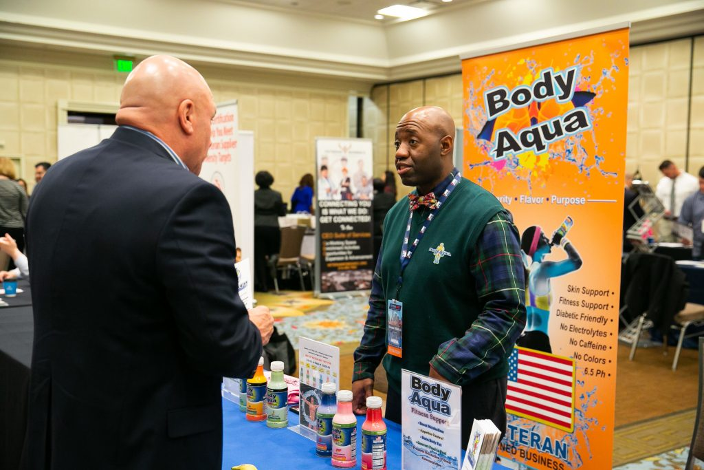 Sherman Williams showing off his product Body Aqua at IVMF's EDGE conference.